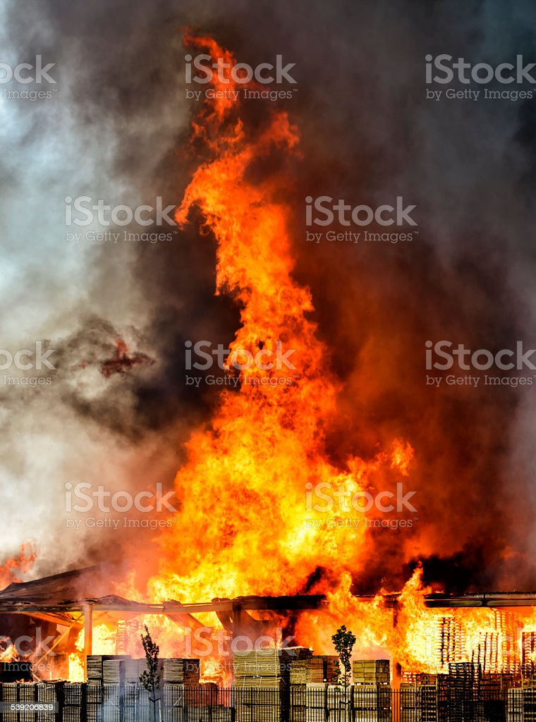 Pallet factory burning in industrial area stock photo