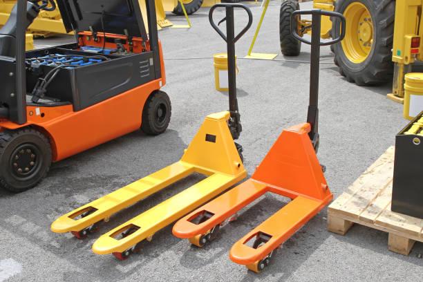 Pallet Jack Forklift Two Pump Trucks Pallet Jacks Forklifts pallet jack stock pictures, royalty-free photos & images