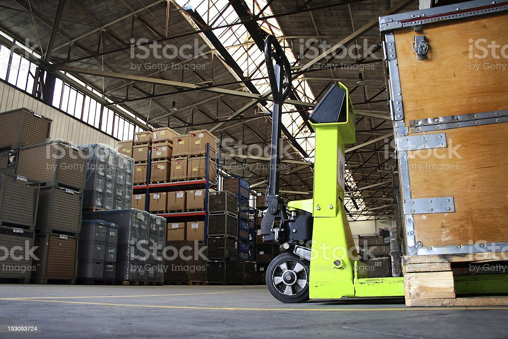 pallet jack in the industrial hall stock photo