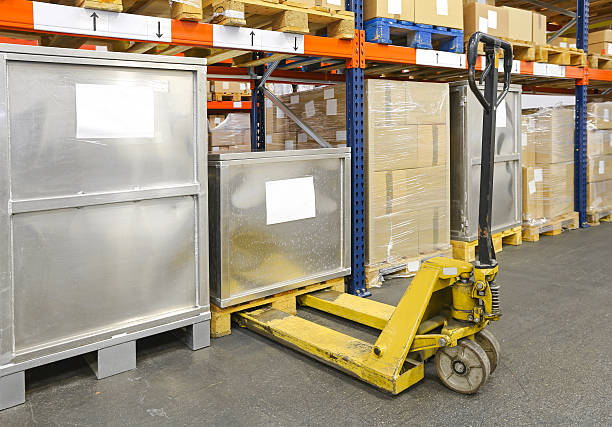 Pallet Jack Pallet Jack Truck in Distribution Warehouse pallet jack stock pictures, royalty-free photos & images
