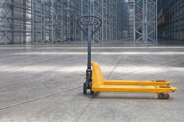 Pallet Jack Warehouse Manual Pallet Jack Truck in Distribution Warehouse pallet jack stock pictures, royalty-free photos & images