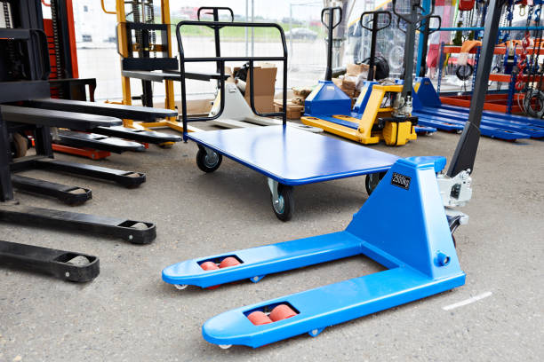 Pallet jacks in store Pallet jacks in industrial store pallet jack stock pictures, royalty-free photos & images
