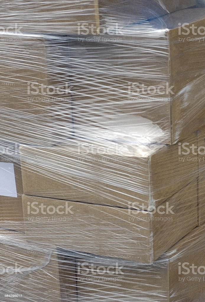 Pallet of wrapped boxes stock photo