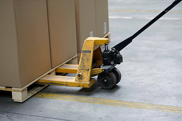 pallet truck with carton boxes  pallet jack stock pictures, royalty-free photos & images