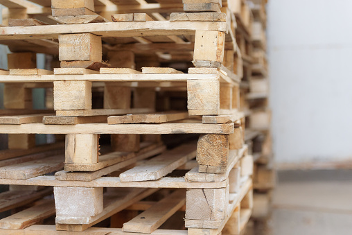 A range of wooden pallets. Inventory for shipment in the warehouse.