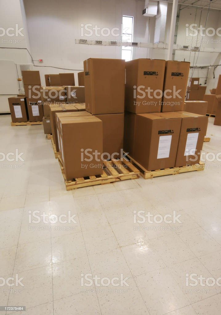 Pallets with boxes in an industry royalty-free stock photo