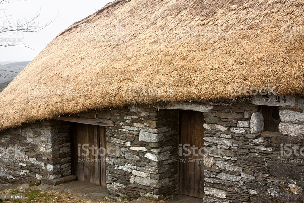 'Palloza'  side view, traditional building with straw roof, stone wall. stock photo
