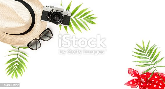 istock Palm green leaves sunglasses photo camera Summer background 994869522