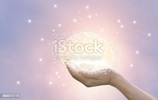 istock Palm hold and protect virtual brain on pastel background, innovative technology in science and medical concept 695372170