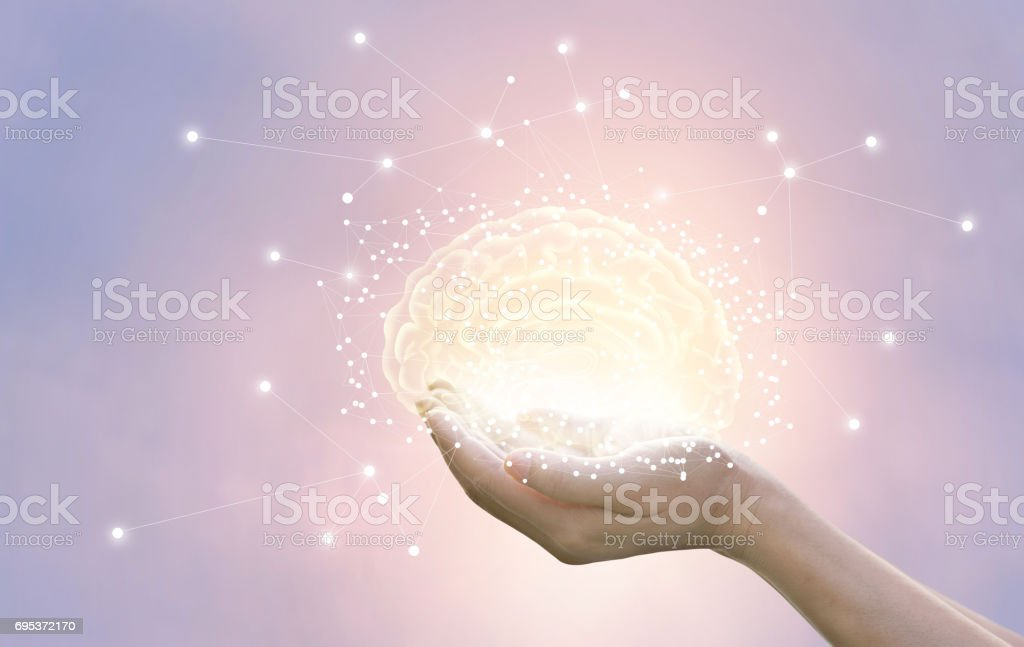 Palm hold and protect virtual brain on pastel background, innovative technology in science and medical concept stock photo