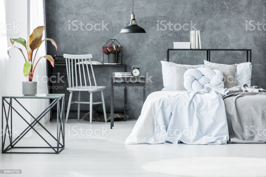 Palm in grey bedroom interior stock photo