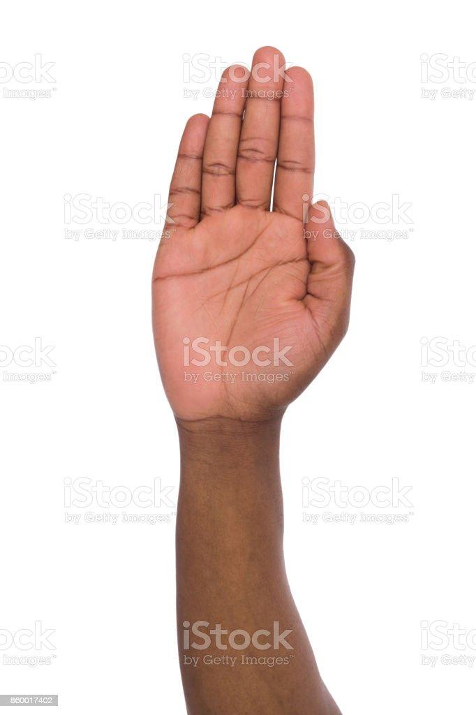 Palm of black man on isolated white background stock photo