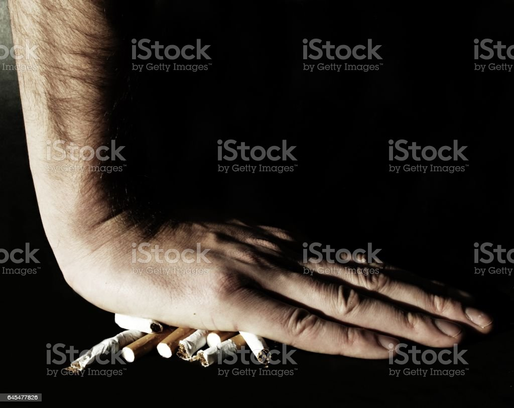 Palm on cigarettes stock photo