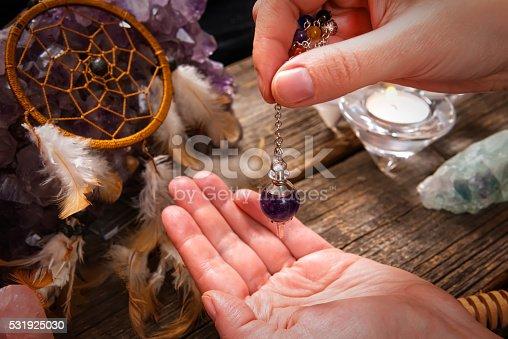 istock Palm reading with pendulum 531925030