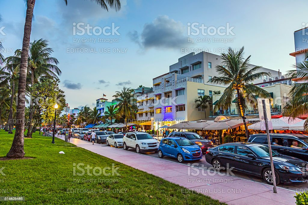 Palm trees and art deco hotels at Ocean Drive stock photo