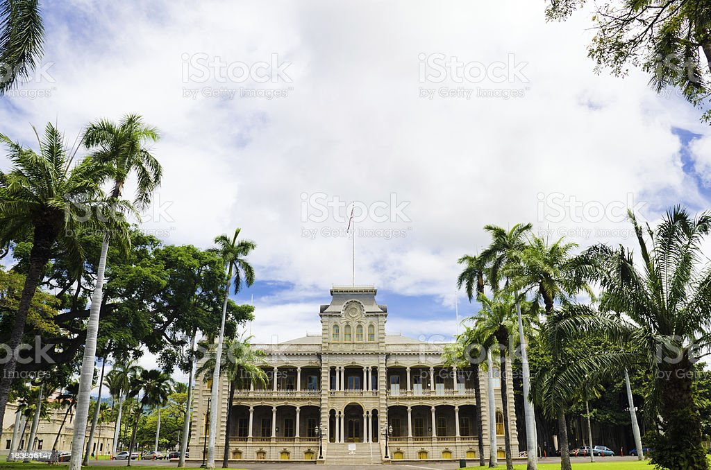Palm trees and sky at Iolani Palace in Honolulu, HI stock photo