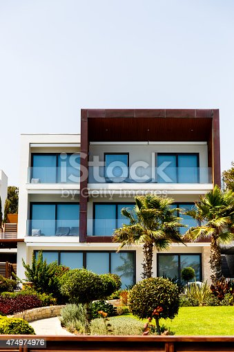946294510 istock photo Palm trees and the hotel 474974976
