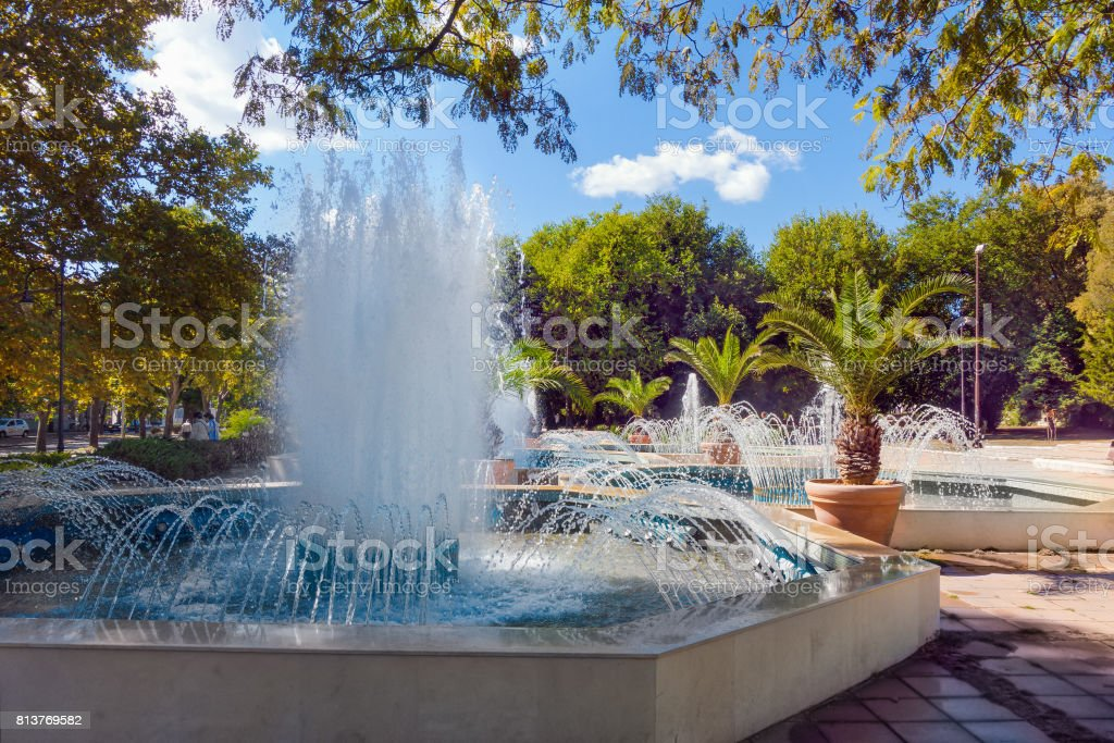 Palm trees and water fountains, Varna, Bulgaria. stock photo