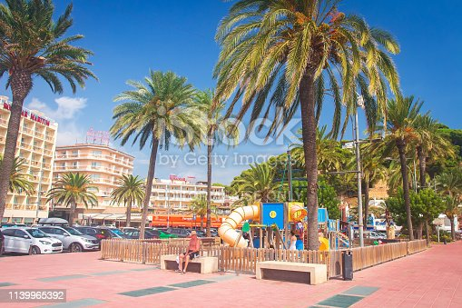 istock Palm trees on the seafront street in Lloret de Mar, Spain on sunny bright day 1139965392