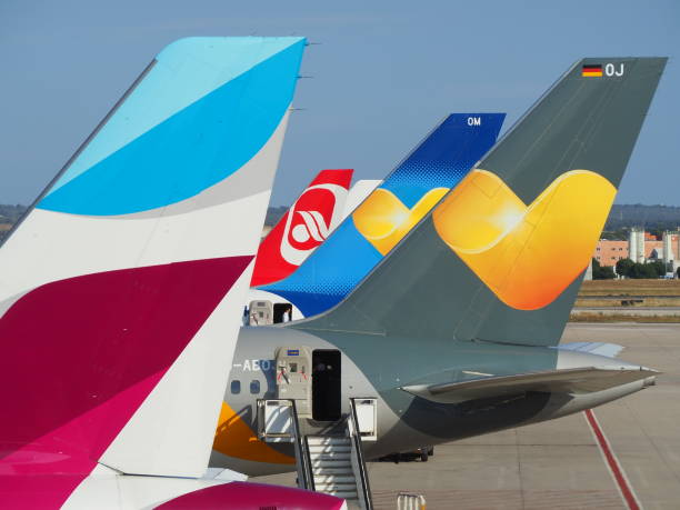 Palma de Mallorca, Spain. Group of vertical stabilizers of different airlines stock photo