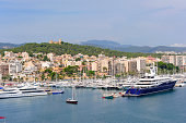 Marina in Palma De Majorca with Bellver castle on the hill