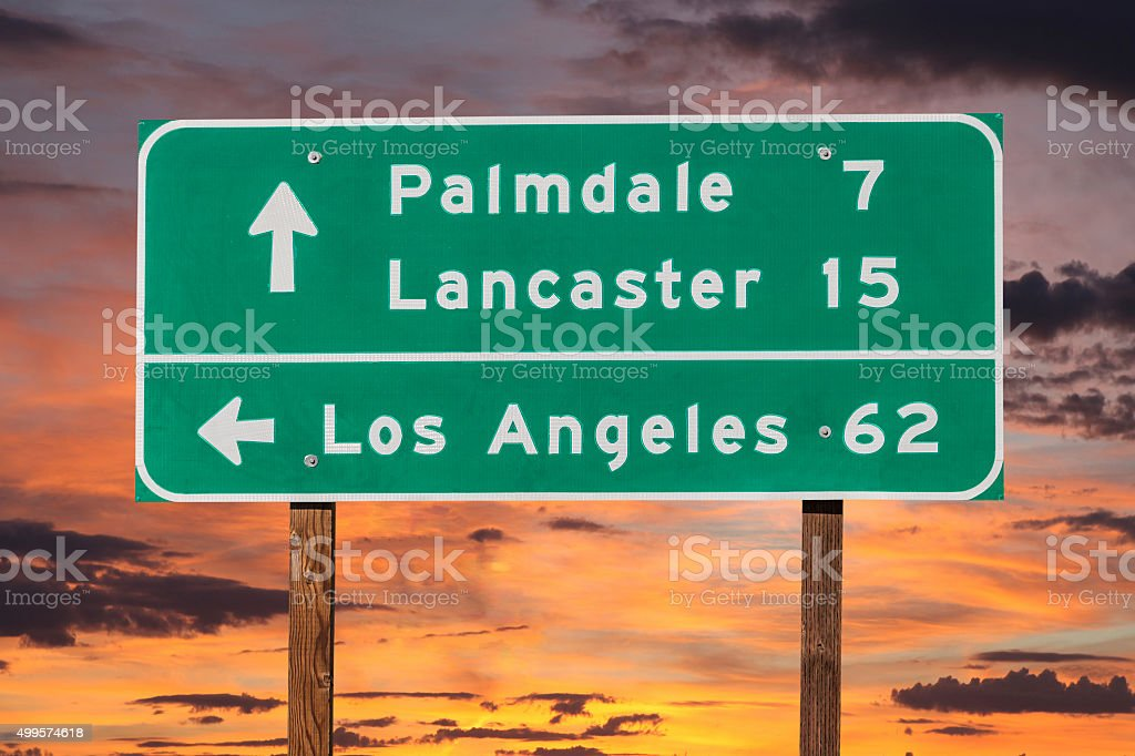 Palmdale, Lancaster and Los Angeles Highway Sign with Sunset stock photo
