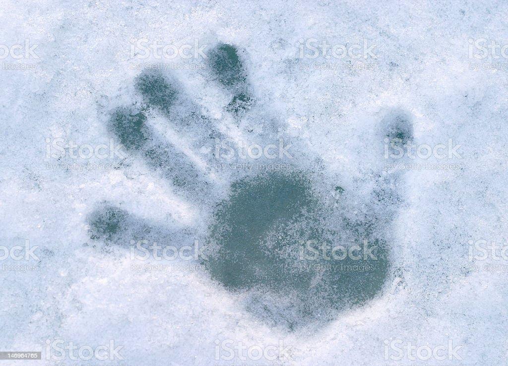 palmprint on blue ice stock photo
