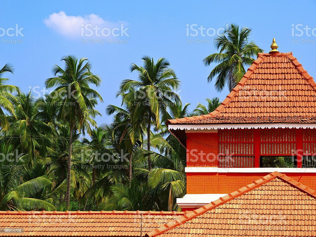 Palms and orange tiled house royalty-free stock photo
