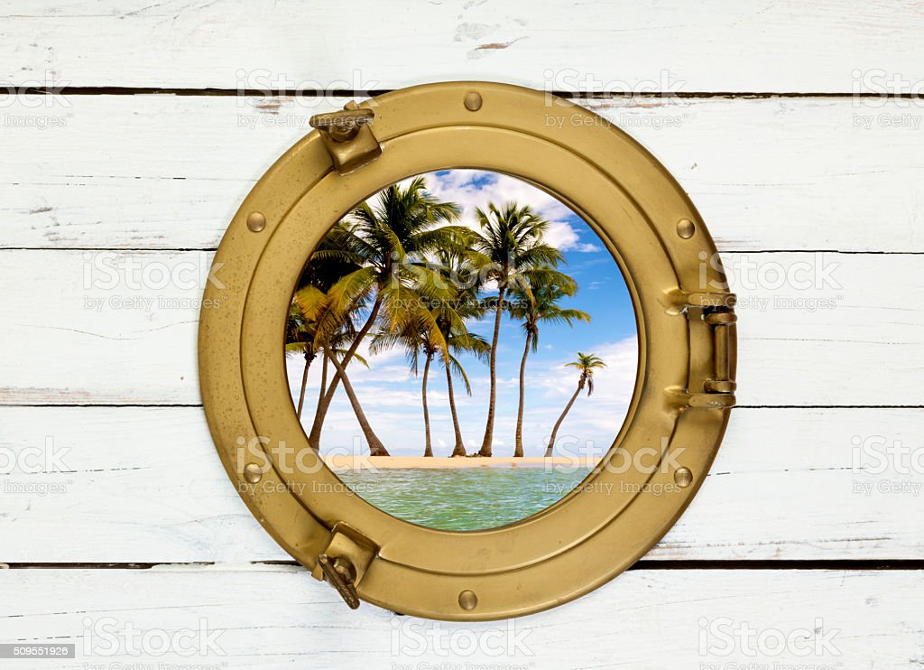 Palms on island seen through vintage porthole stock photo