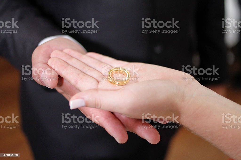 Palms open with wedding rings stock photo