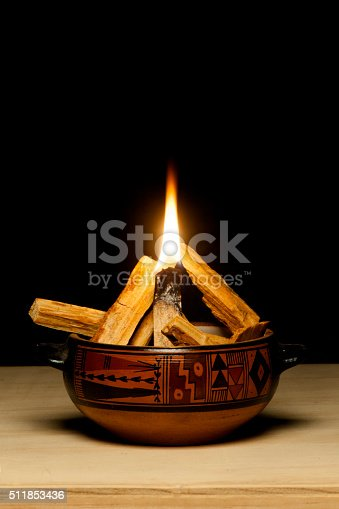 Handcrafted ceramic pot containing Palo Santo chips. Palo Santo is an aromatic wood used as incense by South American cultures since ancient times