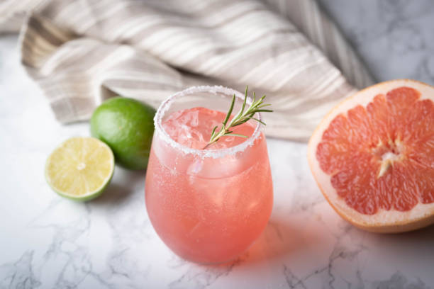 paloma cocktail with grapefruite on marble background stock photo