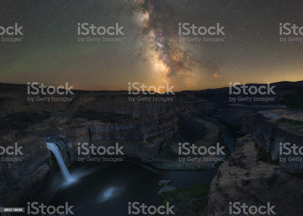 Palouse Falls in Washington State under the Milky Way Galaxy stock photo
