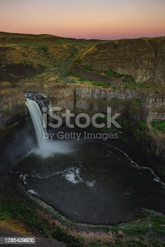 Last light on the horizon of Palouse Falls in Eastern Washington. Palouse Falls State Park is a 105-acre Washington state park in the Palouse region of Eastern Washington, USA. It is named for the 200-foot Palouse Falls on the Palouse River, which are part of the park
