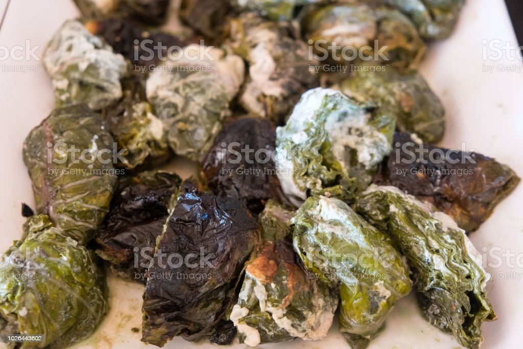 Palusami: traditional Samoan and Polynesian meal of taro vegetable leaves cooked in coconut milk stock photo
