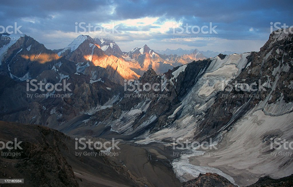 Pamir mountains with a slow sunrise stock photo