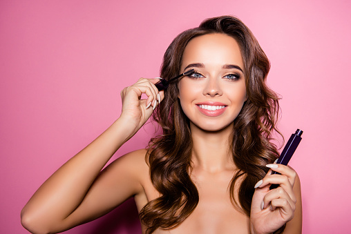 istock Pampering, healthcare perfection concept. Attractive nude gorgeous charming lady with ideal face, healthy shiny clear skin, amazing hairstyle, has tube of mascara in arm 925950766
