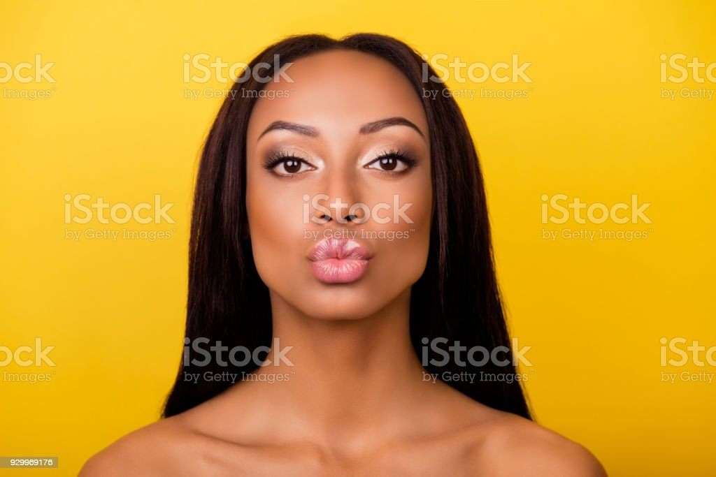 Pampering, lips correction, dermatology, dream, healthcare concept. Cose up cropped photo of afro gorgeous charming brunette with ideal face sending an air kiss, so romantic! stock photo