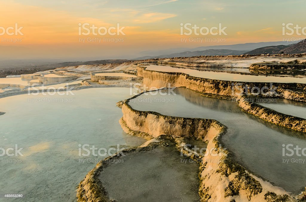Pamukkale, Carbonate travertines the natural pools during sunset. stock photo
