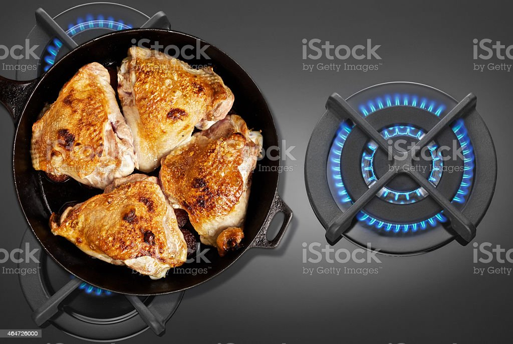 Pan fried chicken on the gas stove stock photo