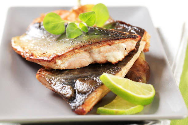 pan fried fish fillets - trout foto e immagini stock