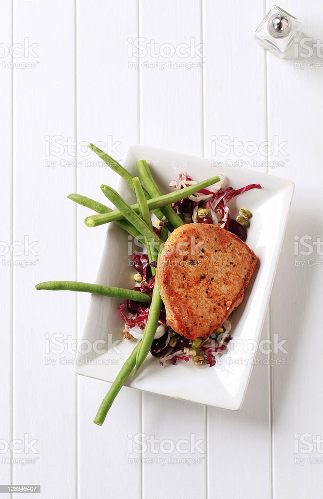 Pan fried pork chop and vegetables royalty-free stock photo