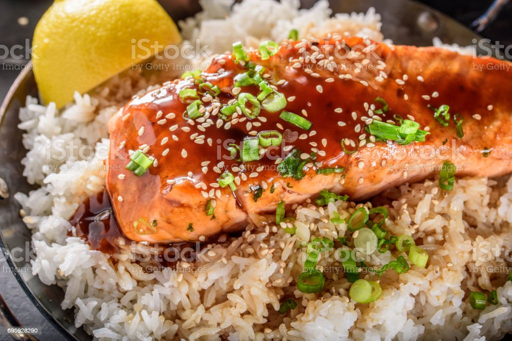 Pan Fried Salmon Steak with Teriyaki Sauce over Rice stock photo