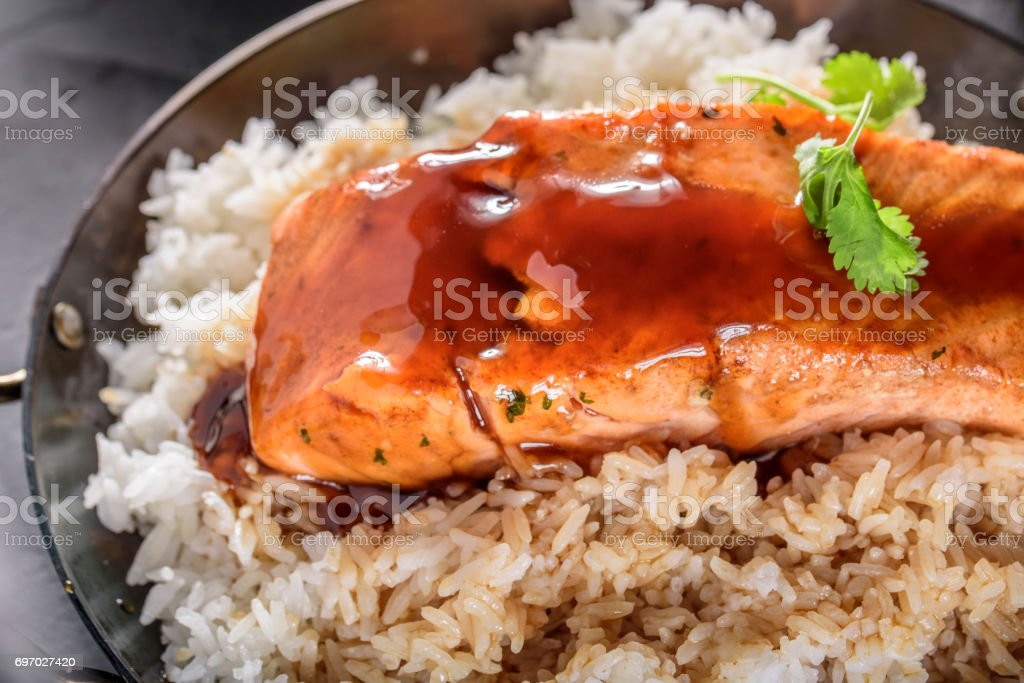 Pan Fried Salmon Steak with Teriyaki Sauce over Rice stock photo