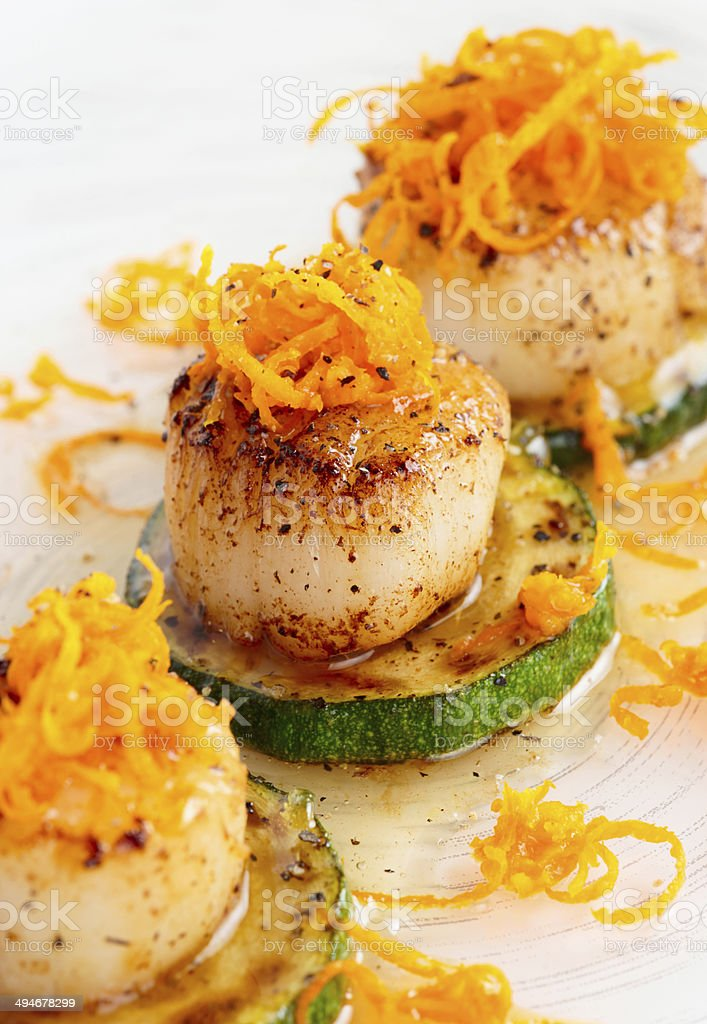 Pan fried scallops with citrus zest stock photo