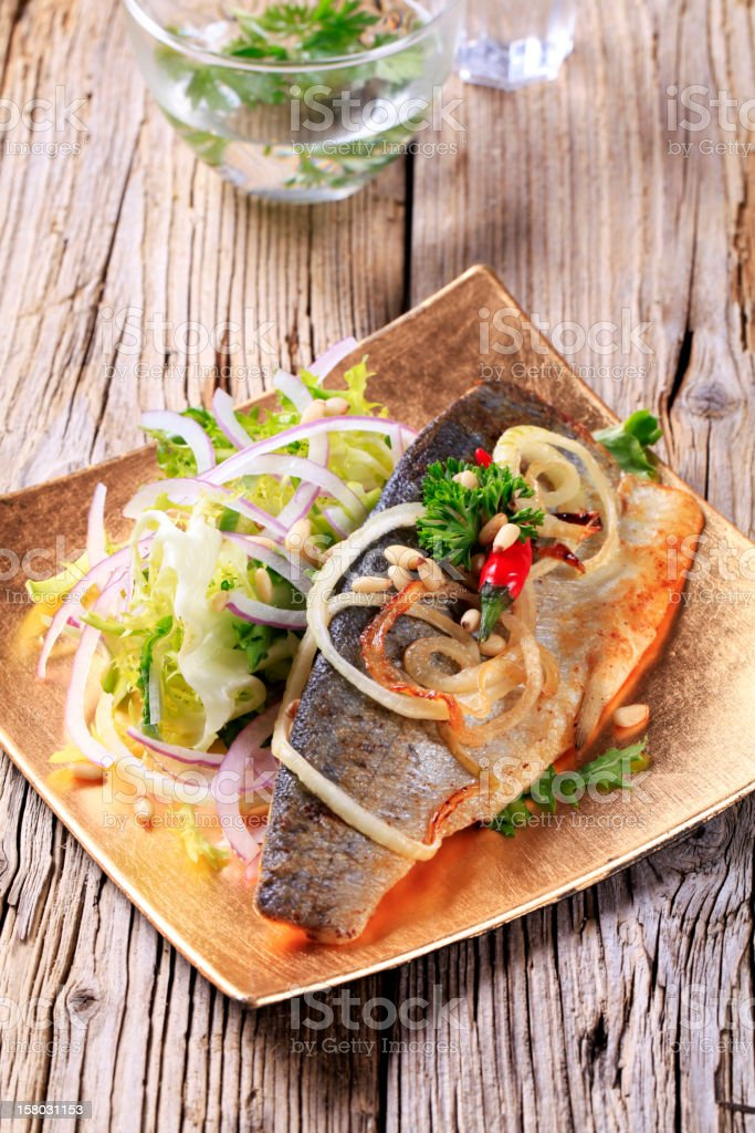 Pan fried trout with green salad royalty-free stock photo