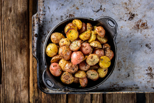 Pan Fried Yukon Gold Potatoes with Herb in Cast iron stock photo