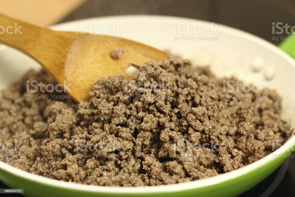 Pan frying ground beef stock photo
