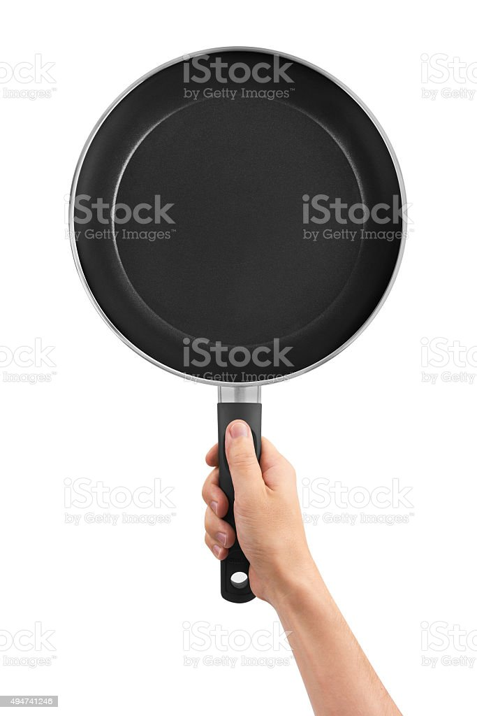 Pan in hand stock photo