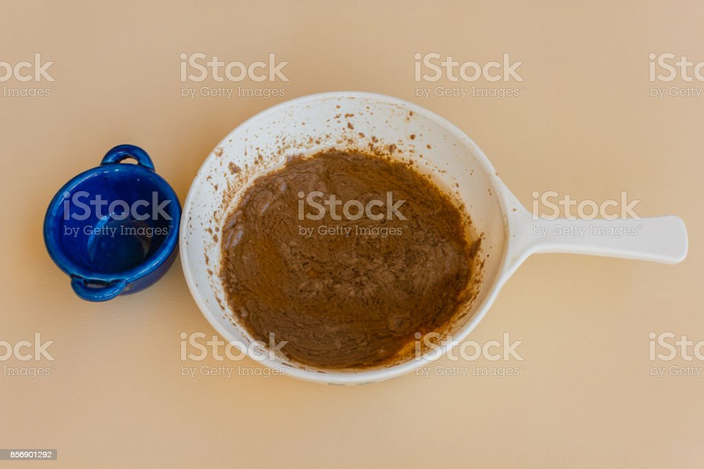 pan of bagna cauda with a small pan stock photo